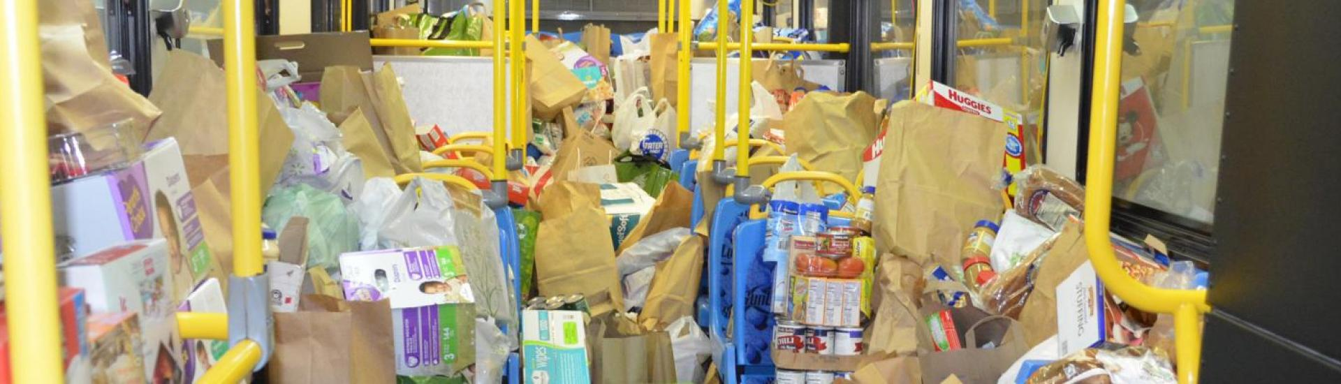 Fill the Bus image of collected food and hygiene items